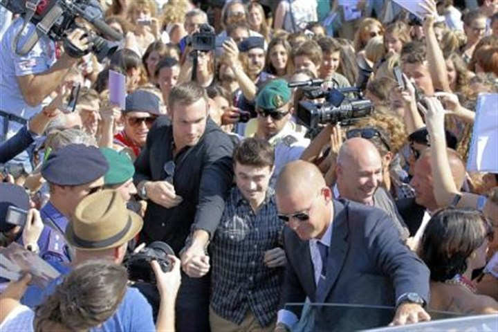 "Daniel Radcliffe Actor Daniel Radcliffe is mobbed by fans as he leaves a press conference for his film ""Kill Your Darlings"" on Sunday at the Venice Film Festival. He is on his way to the Toronto International Film Festival."