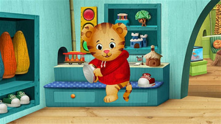 "'Daniel Tiger's Neighborhood' Daniel Tiger changes into sneakers, a nod to Fred Rogers on ""Mister Rogers' Neighborhood,"" in the new series ""Daniel Tiger's Neighborhood,"" set to debut on PBS stations nationwide in the fall of 2012."