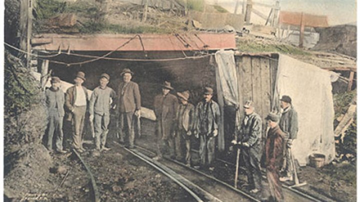 """Darkest Month"" This vintage photo of the rescue party at the Darr Mine explosion in Fayette County is part of the ""Darkest Month"" coal mining exhibit at the Heinz History Center."