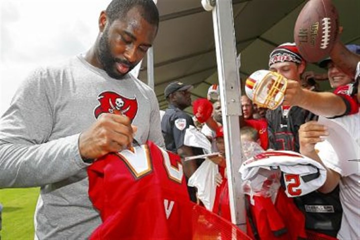 Darrelle Revis Aliquippa High School graduate Darrelle Revis signs autographs after a training camp practice last month in Tampa, Fla. Revis was traded to the Buccaneers in the offseason.