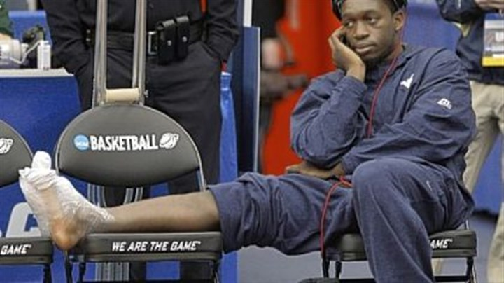 Darryl Bryant Injured West Virginia guard Darryl Bryant watches the Mountaineers at practice Wednesday in the Carrier Dome in Syracuse, N.Y.