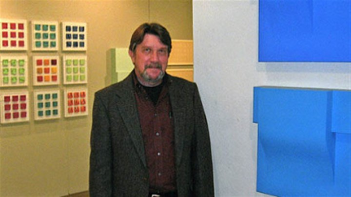 "David Ludwig Artist David Ludwig in 2009 with his exhibition ""Continuum"" at Westmoreland County Community College. In the background are examples of his maquettes, an early stage of his working process."