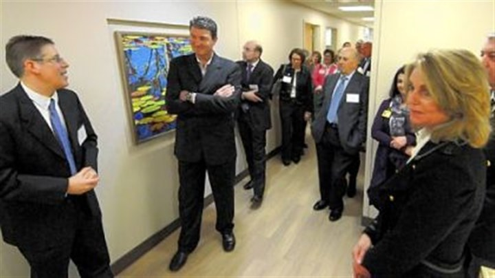 David Wells and Mario Lemieux Mario Lemieux listens to tour guide David Wells at the opening of the new Mario Lemieux Center for Blood Cancers at the Hillman Cancer Center. Natalie Lemieux is at right.