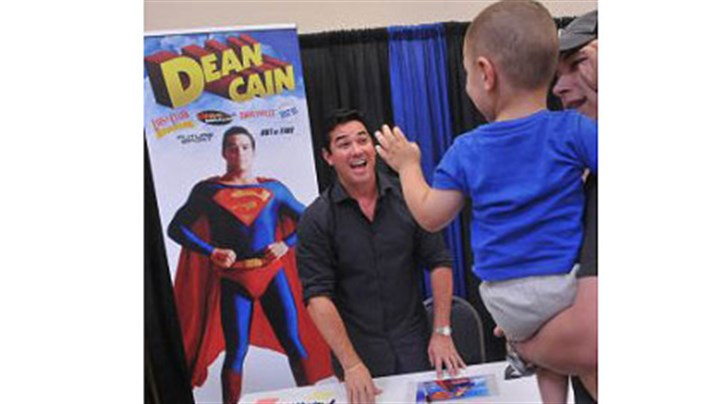 "Dean Cain and Pittsburghers Dean Cain, who played Superman in the TV series ""Lois and Clark,"" has a big smile for 2-year-old Brycen Bedard of Pittsburgh at the Steel City Con in Monroeville Convention Center."