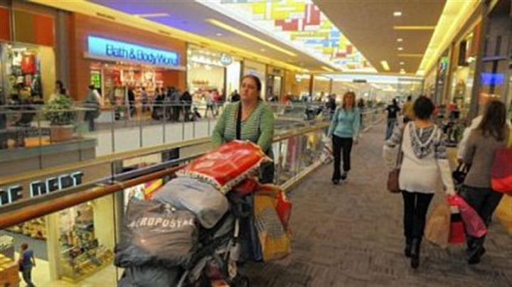 Deb Castro pushes a stroller Deb Castro of Woodbridge, Va., pushes a stroller loaded with shopping items that she and her three sisters bought Friday at the Mall at Robinson.
