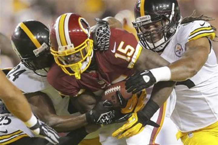 defense Steelers free safety Ryan Clark, left, cornerback Ike Taylor, center, and linebacker Jarvis Jones combine to tackle Redskins wide receiver Josh Morgan in a preseason game Aug. 19 in Landover, Md.