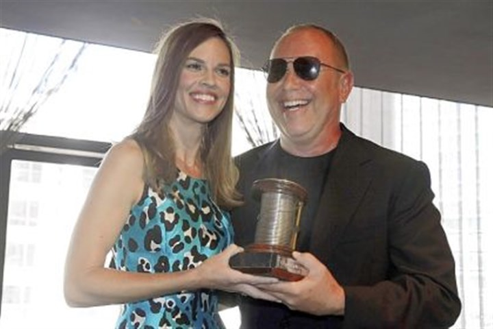 Designer Michael Kors Designer Michael Kors receives the 2013 Couture Council Award for Artistry of Fashion from actress Hilary Swank during a luncheon Wednesday in the David H. Koch Theater of New York's Lincoln Center.