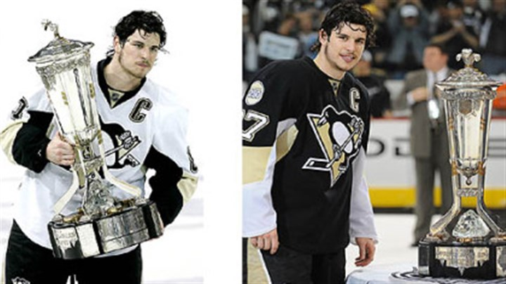 Different paths, same goal Sidney Crosby's approach to the Prince of Wales Trophy this year and last year are as different as the routes the Penguins took to reach the Stanley Cup final. Last season, above right, he refused to touch it. Tuesday night, left, he embraced it.