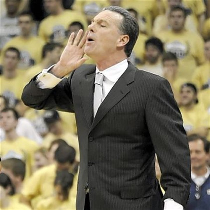 "DixonBigEast.jpg Pitt coach Jamie Dixon on the Big East: ""Ten years later, I think it worked. I think it worked better than what maybe they thought. Football schools were getting value out of the basketball-only schools and the basketball-only schools were getting value out of the football schools."""