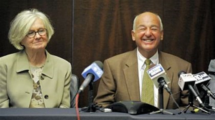 Dr. Cyril H. Wecht Dr. Cyril H. Wecht, seated by his wife Sigrid Wecht, speaks at a news conference about the dismissal of all charges against him.
