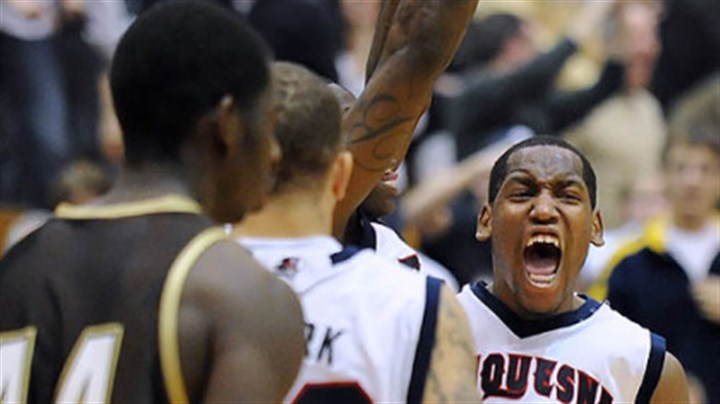 Duquesne's Damian Saunders celebrates Duquesne's Damian Saunders celebrates the Dukes' 70-69 win vs. St. Bonaventure at the Palumbo Center -- their first A-10 win of the season.