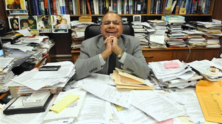 Duquesne University professor of medicinal pharmacy Aleem Gangjee Duquesne University professor of medicinal pharmacy Aleem Gangjee and an ocean of paperwork.