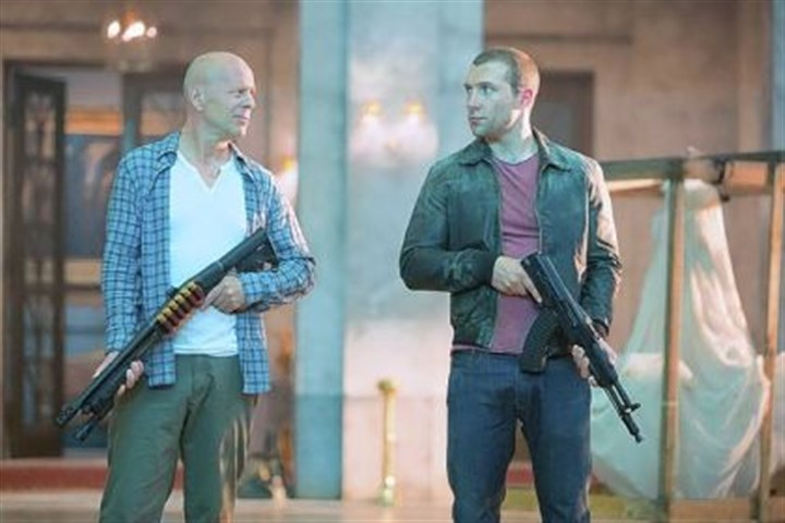 "DVD review: 'Die Hard Five' Bruce Willis, left, is back as John McClane, with Jai Courtney as his son, Jack, in ""A Good Day to Die Hard."""