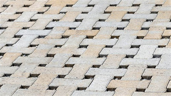 Eco-Tek pavers The gaps between Eco-Tek permeable pavers allow rainwater to pass through.