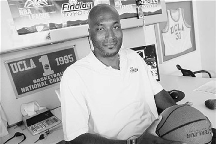"Ed O'Bannon Jr. Former UCLA basketball player Ed O'Bannon Jr. sits in his office in Henderson, Nev., in this 2010 photo. O'Bannon is part of a lawsuit seeking revenue sharing for NCAA athletes. ""There are millions and millions of dollars being made off the sweat and grind of the student athlete,"" O'Bannon said. ""Student athletes see none of that other than their education."""