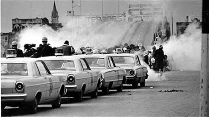 Edmund Pettus Bridge in Selma As the march began on March 7, 1965, Alabama state troopers fired tear gas on participants at the Edmund Pettus Bridge in Selma, then assaulted the marchers with clubs and whips.
