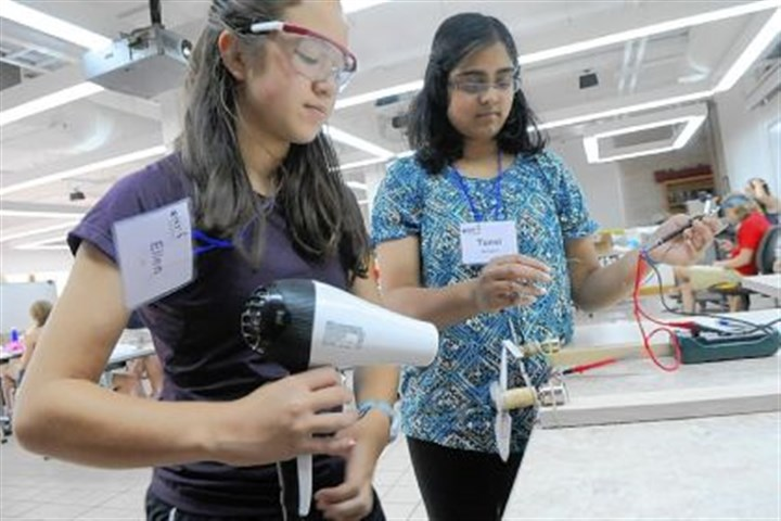 ellen pil tanvi meringenti Anna Bentley/Post-Gazette - Shot on Thursday, July 18, 2013 - Ellen Pil, 13, (left) of Fox Chapel, and Tanvi Meringenti , 14, of Cheswick, measure the power output of the wind turbines they made by blowing them with a hair dryer during the Summer Engineering Experience for Girls day camp at CMU on Thursday, July 18.