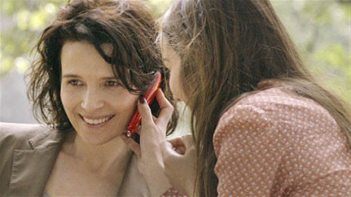 """Elles"" Playing a journalist, Juliette Binoche (left) gets involved in a story about college call girls, including Anais Demoustier, in ""Elles."""