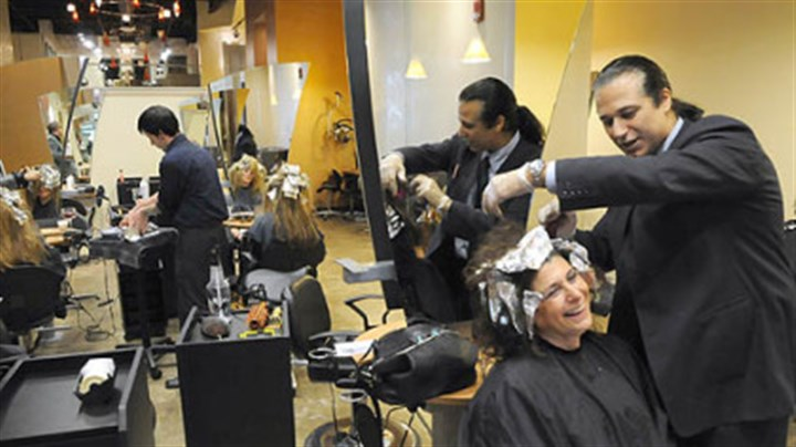 Emilio Cornacchione and Denis Robinson Emilio Cornacchione, right, proprietor of Izzazu salon, works on client Denis Robinson's hair in the salon's new digs next to the Capital Grill on Fifth Ave.