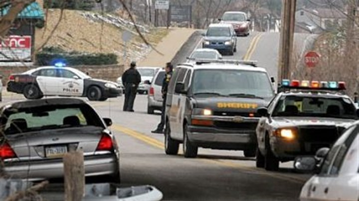 End of chase Police investigate the scene on Beatty Road in Monroeville where a 10-mile chase ended on Friday.