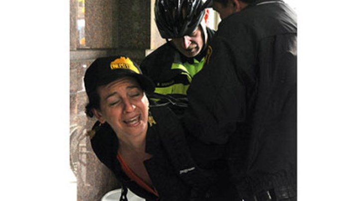 eqt meeting Rosalie Hannah, of Shadyside, was taken into custody at EQT Plaza during protests Wednesday.