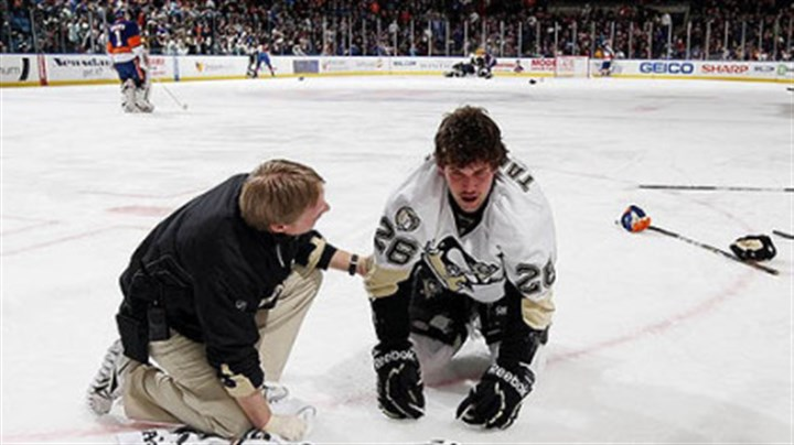 Eric Tangradi and Chris Stewart The Penguins' Eric Tangradi is tended by athletic trainer Chris Stewart after taking a hit to the head from the Islanders' Trevor Gillies Friday in Uniondale, N.Y.
