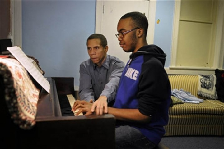 eugene Eugene Perry teaches piano to Travonne Henderson, 14, of West Oakland, at The Corner, on Robinson Street at Terrace Street, which serves as a community center run by the West Oakland Neighborhood Council and Friendship Community Presbyterian Church.