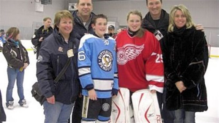 Family crossover: Lemieux and Crosby From left, Trina Crosby, Troy Crosby, Austin Lemieux, Taylor Crosby, Mario Lemieux and Nathalie Lemieux pose for a photograph at a peewee tournament last month in Quebec where Austin's and Taylor's teams met in a special exhibition game.
