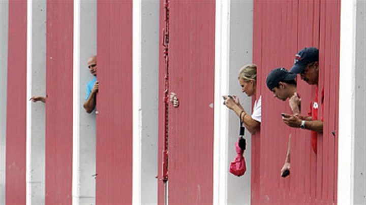 Fans Spectators watch from a parking garage as All-Star players are driven to Busch Stadium before the game.