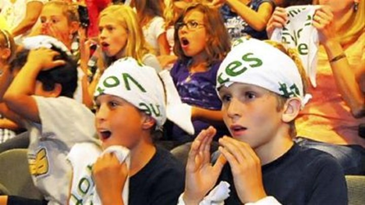Fans react Classmates of Jackie Evancho react to her second-place finish as they watch the television show at the auditorium of Eden Hall Upper Elementary School in Pine-Richland School District.