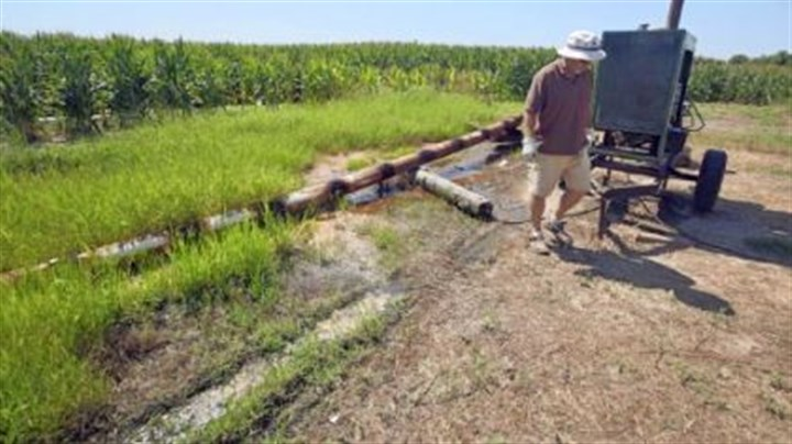Farm worker Porky Harrison Farm worker Porky Harrison walks past a diesel-powered irrigation pump at a Tucker, Ark., corn field in June. Many Arkansas fields have required 24-hour irrigation for much of the growing season due to hot weather and a lack of rain.