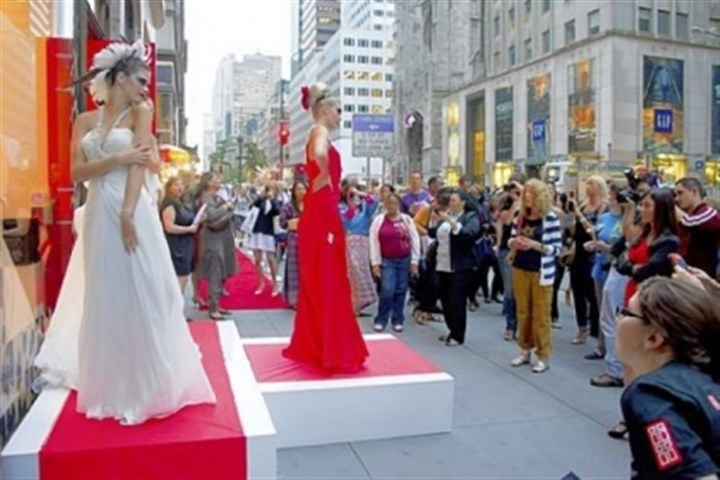 Fashion's Night Out Models pose outside the Elizabeth Arden store on Fifth Avenue during Fashion's Night Out in New York in 2011. The annual shopping event, a part of New York Fashion Week since 2009, has been discontinued.