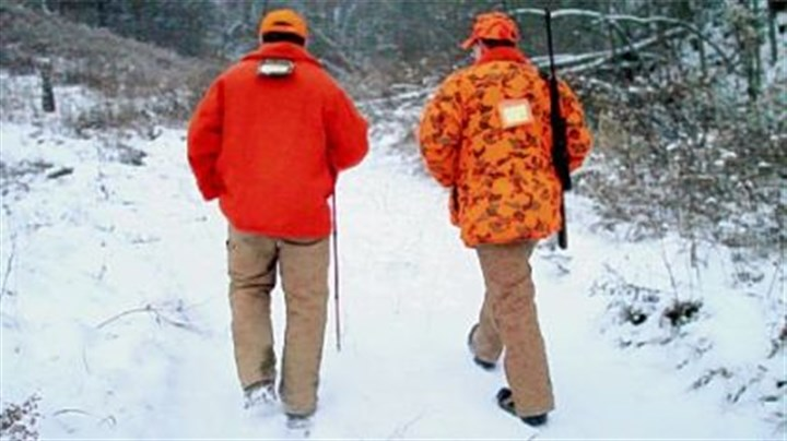 Father Mike Zavage and his father Mike Zavage Father Mike Zavage, 28, right, hunts with his father, Mike Zavage, 55, of Carmichaels, Greene County, in Oak Forest, Greene County.