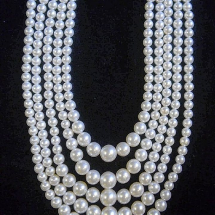 Faux pearl necklace A classic 1950s faux pearl necklace is an example of vintage jewelry available at Eons.