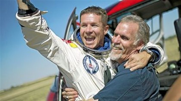 Felix Baumgartner and Art Thompson celebrate Felix Baumgartner, left, of Austria and technical project director Art Thompson celebrate after Mr. Baumgartner parachuted safely Sunday into the New Mexico desert about nine minutes after jumping from a capsule roughly 24 miles above Earth, breaking the sound barrier during his plunge.