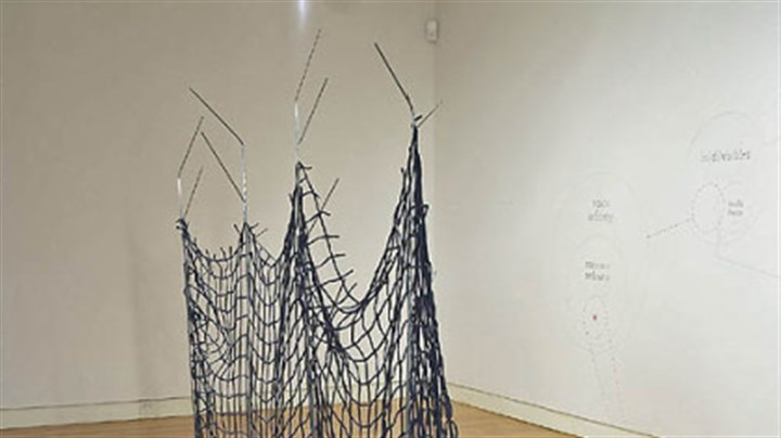 """Fence"" ""Fence,"" a 2006 sculpture made of steel and cotton, is among several works by Sarah E. Wood in ""Plastic Poetics"" at the Regina Gouger Miller Gallery, Carnegie Mellon University. Wood is one of four artists in the exhibition."