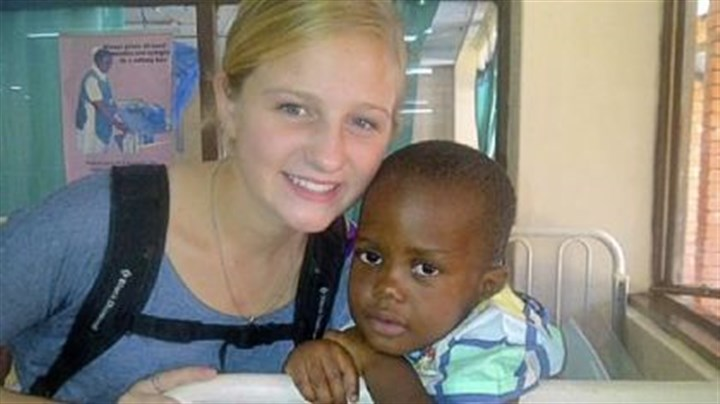 Field hockey Mt. Lebanon field hockey player Meghan Schneck with patient Ninzu Pinta on her trip to Zambia earlier in the fall.
