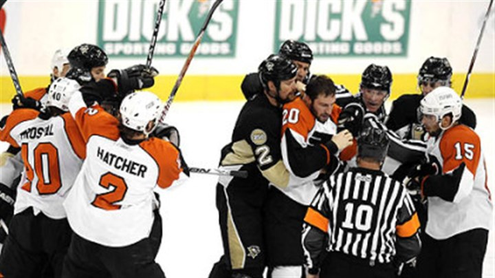 Fight Penguins and Flyers fight during the second period Sunday.