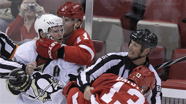 Fight Club Matt Cooke (24) is pulled by Detroit Red Wings' Dan Cleary (11) as linesman Darren Gibbs (66) pulls Red Wings' Pavel Datsyuk (13).