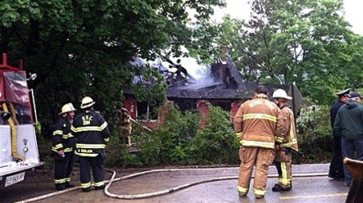 Fire Firefighters survey the scene of a home in Bethel Park where flames broke out early Friday morning.