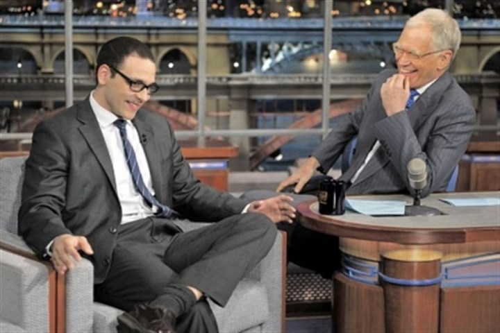 "Fired TV anchor Former news anchor A.J. Clemente, left, has a laugh with host David Letterman on the ""Late Show With David Letterman."""