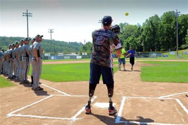 First pitch The Marine Corps' Matias Ferreira catches a ceremonial pitch from Brandon Rumbaug, 24, at Lew Hays Pony Field in Washington, Pa., on Saturday.