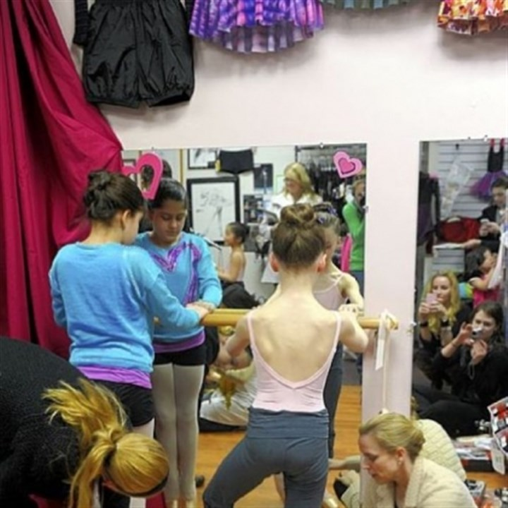 First pointe shoes for ballet students Pittsburgh Ballet School dancers Polina Giaramita, left, 10, of Wexford and Gianna Christensen, 10, of Pine, are fitted for their pointe shoes by Victoria Blackburn, far left, and Anastasia Wovchko at The Dancer's Pointe in the Strip District.