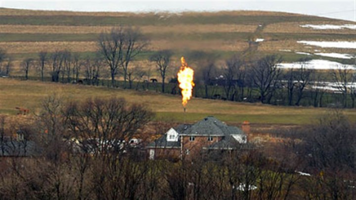 Flaring Flames shoot from a well in Mount Pleasant. Washington County.