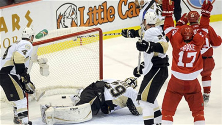 Flattened Mikael Samuelsson's shot ends up behind Marc-Andre Fleury in the second period to give the Red Wings a 2-0 lead in Game 1 last night at Joe Louis Arena in Detroit.