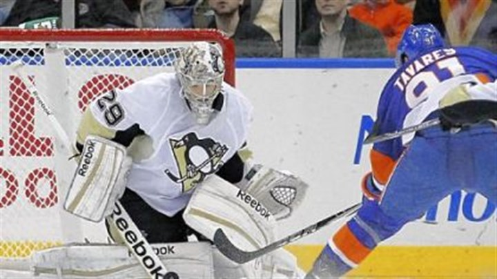 Fleury Penguins goalie Marc-Andre Fleury stops a shot by New York's John Tavares -- one of the 33 saves he made en route to his 20th career shutout in the Penguins' 3-0 victory Tuesday in Uniondale, N.Y.