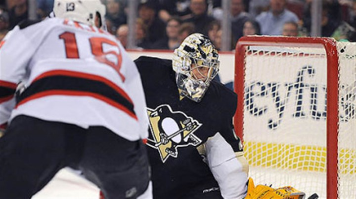 Fleury_save Penguins goalie Marc-Andre Fleury makes a save on the Devils' Dainius Zubrus.
