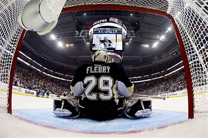 Fleury stretches Speculation abounds about who will start in goal tonight for the Penguins.