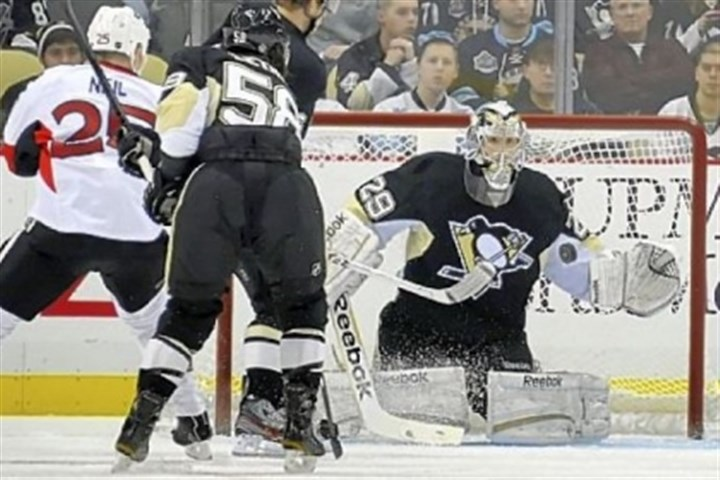 Fleury1 Marc-Andre Fleury makes one of his 27 saves in winning for the sixth time this season.