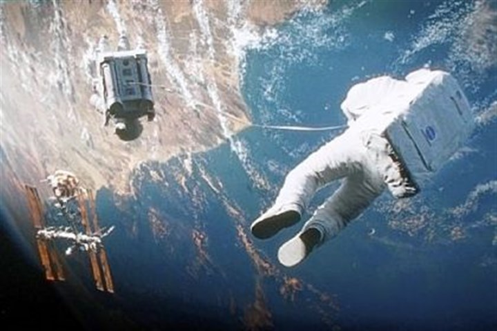 "Floating in Gravity Sandra Bullock is adrift in space in Alfonso Cuaron's ""Gravity."""